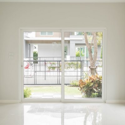 empty glass door in living room interior background